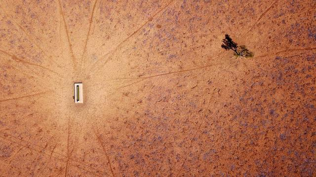 FILE PHOTO: A lone tree stands near a water trough in a drought-effected paddock located on the outskirts of Walgett, in New South Wales, Australia, July 20, 2018. REUTERS/David Gray/File Photo