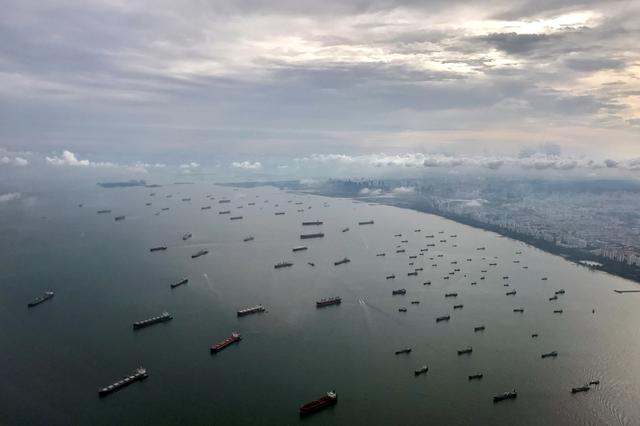 FILE PHOTO: A bird's-eye view of ships along the coast in Singapore July 9, 2017. REUTERS/Jorge Silva -/File Photo
