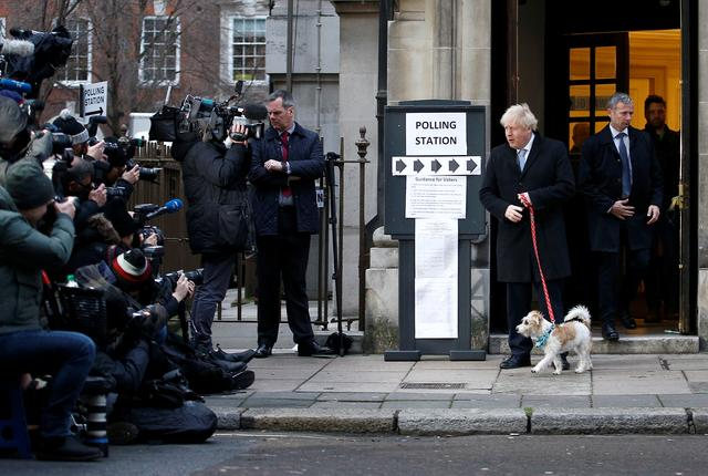 Britain's Prime Minister Boris Johnson arrives with his dog Dilyn at a polling station, at the Methodist Central Hall, to vote in the general election in London, Britain, December 12, 2019. REUTERS/Henry Nicholls