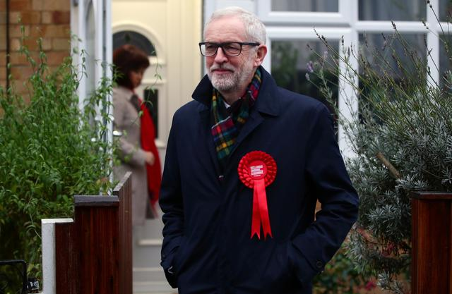 Britain's opposition Labour Party leader Jeremy Corbyn leaves his house to head to a polling station to vote in the general election in London, Britain, December 12, 2019. REUTERS/Lisi Niesner