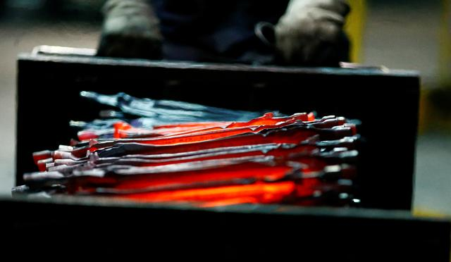 FILE PHOTO: Unfinished pliers still glow after being hot-formed by a hammer at the factory of Knipex, a 130 year-old family-owned pliers and tools maker company in Wuppertal, western Germany, October 25, 2016.    REUTERS/Wolfgang Rattay