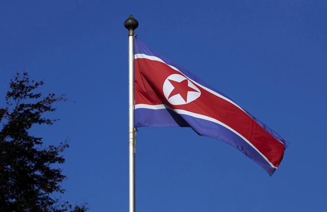 FILE PHOTO: A North Korean flag flies on a mast at the Permanent Mission of North Korea in Geneva October 2, 2014.   REUTERS/Denis Balibouse/File Picture