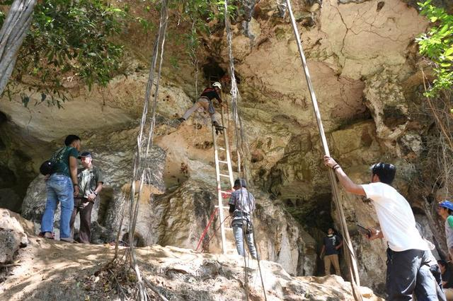 A team of archaeologists and researchers from Indonesia's National Research Centre for Archaeology and Griffith University, work in Leang Bulu' Sipong 4 limestone cave in South Sulawesi, Indonesia December 4, 2019. Picture taken December 4, 2019. Courtesy of Indonesia's National Research Centre for Archaeology/Griffith University/Handout via REUTERS THIS IMAGE HAS BEEN SUPPLIED BY A THIRD PARTY. MANDATORY CREDIT