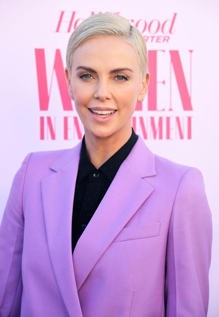 FILE PHOTO: Charlize Theron attends the Hollywood Reporter's annual Women in Entertainment Breakfast Gala in Los Angeles, California, U.S., December 11, 2019. REUTERS/Phil McCarten