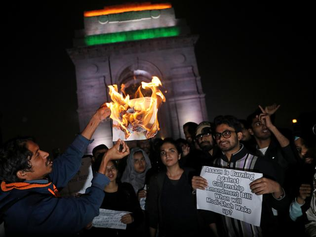 Demonstrators burn a copy of Citizenship Amendment Bill, a bill that seeks to give citizenship to religious minorities persecuted in neighbouring Muslim countries, during a protest in New Delhi, India, December 12, 2019. REUTERS/Anushree Fadnavis