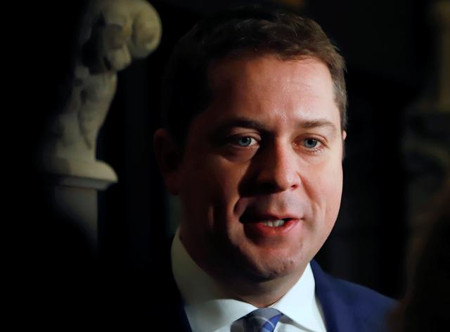FILE PHOTO: Conservative Party leader and Leader of the Official Opposition Andrew Scheer speaks to reporters after meeting with Canada's Prime Minister Justin Trudeau on Parliament Hill in Ottawa, Ontario Canada November 12, 2019.  REUTERS/Patrick Doyle