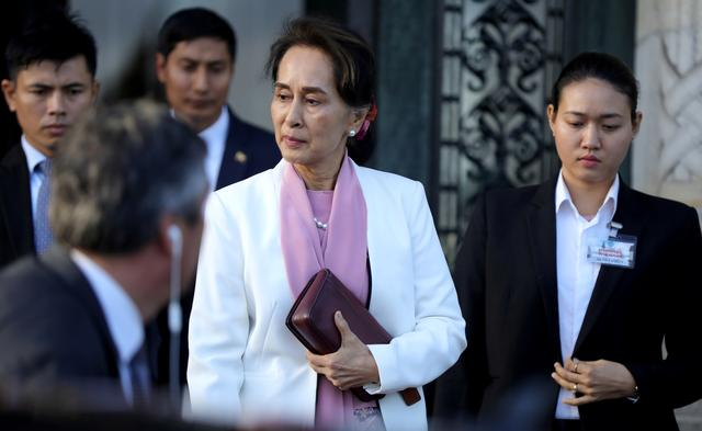 Myanmar's leader Aung San Suu Kyi leaves the International Court of Justice (ICJ), the top United Nations court, during court hearings in a case filed by Gambia against Myanmar alleging genocide against the minority Muslim Rohingya population, in The Hague, Netherlands December 12, 2019.  REUTERS/Eva Plevier