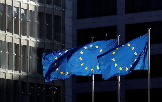 European Union flags fly outside the European Commission headquarters in Brussels, Belgium, December 12, 2019. REUTERS/Yves Herman