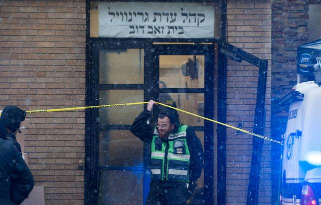 FILE PHOTO: Emergency personnel and investigators work at the scene the day after an hours-long gun battle with two men around a kosher market in Jersey City, New Jersey, U.S., December 11, 2019. REUTERS/Lloyd Mitchell