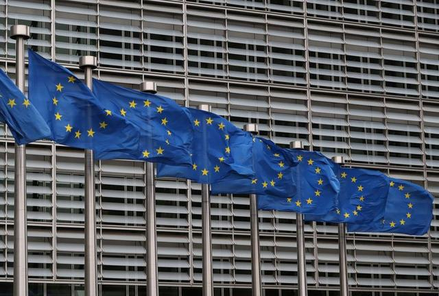 European Union flags fly near the European Commission headquarters in Brussels, Belgium, October 4, 2019. REUTERS/Yves Herman