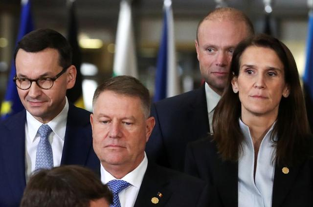 Poland's Prime Minister Mateusz Morawiecki, Romanian President Klaus Iohannis, Malta's Prime Minister Joseph Muscat and Belgium's Prime Minister Sophie Wilmes pose for a family photo at the European Union leaders summit in Brussels, Belgium December 12, 2019. REUTERS/Yves Herman