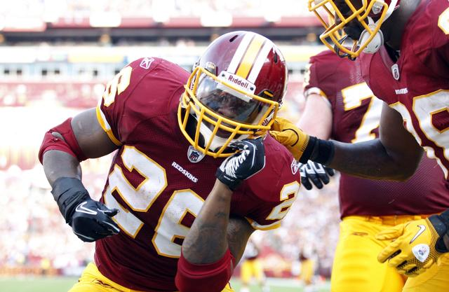 FILE PHOTO: Washington Redskins Clinton Portis celebrates his second touchdown in the second quarter against the Houston Texans during their NFL football game in Landover, Maryland September 19, 2010.  REUTERS/Molly Riley/File Photo
