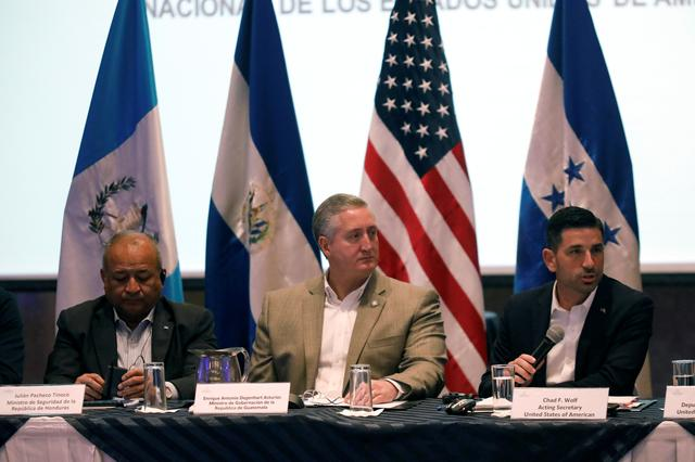 U.S. Acting DHS Secretary Chad Wolf speaks next to Honduran Minister of Security Julian Pacheco and Guatemala's Interior Minister Enrique Degenhart during a meeting in Guatemala City, Guatemala December 12, 2019. REUTERS/Luis Echeverria