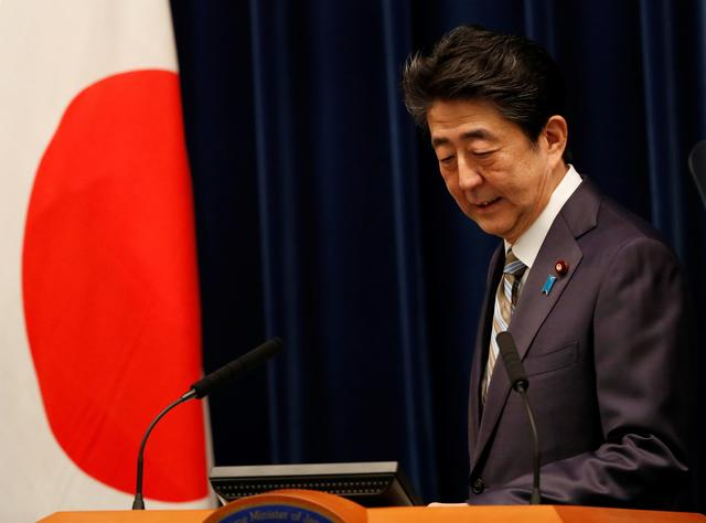 FILE PHOTO: Japan's Prime Minister Shinzo Abe attends a news conference in Tokyo, Japan, December 9, 2019. REUTERS/Kim Kyung-Hoon