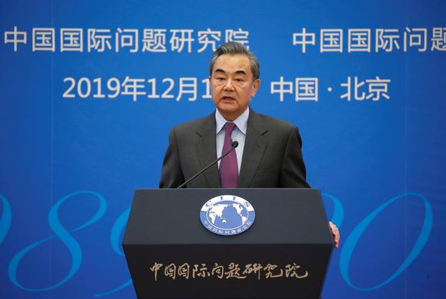 Chinese Foreign Minister Wang Yi delivers a speech at an annual symposium on international situation and China's diplomacy in Beijing, China December 13, 2019. REUTERS/Jason Lee