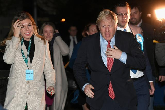 British Prime Minister Boris Johnson and Carrie Symonds arrives at the counting centre in Britain's general election in Uxbridge, Britain, December 13, 2019. REUTERS/Toby Melville
