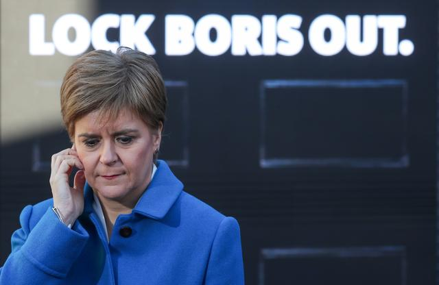 """FILE PHOTO: Leader of the Scottish National Party Nicola Sturgeon attends a """"Lock Boris Out"""" photo opportunity as she campaigns in Coatbridge, Scotland, Britain, December 9, 2019.  REUTERS/Russell Cheyne"""