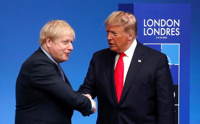 FILE PHOTO: Britain's Prime Minister Boris Johnson shakes hands with President Donald Trump during a welcoming ceremony at the NATO leaders summit in Watford, Britain December 4, 2019. REUTERS/Christian Hartmann/Pool