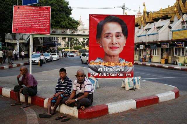 A poster supporting Aung San Suu Kyi as she attends a hearing at the International Court of Justice is seen in a road in Yangon, Myanmar, December 12, 2019. REUTERS/Ann Wang