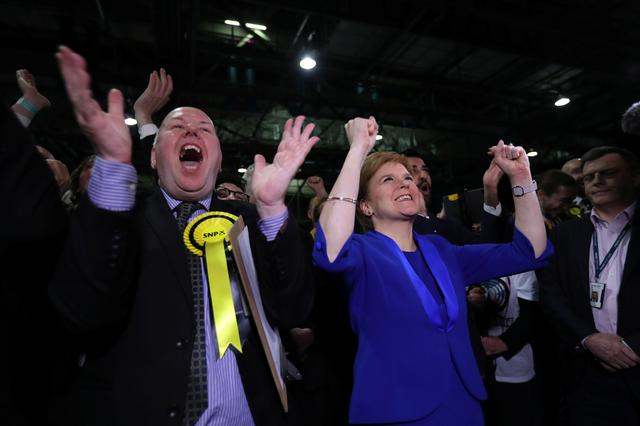 Leader of the Scottish National Party Nicola Sturgeon cheers with supporters at a counting centre for Britain's general election in Glasgow, Britain, December 13, 2019.  REUTERS/Russell Cheyne