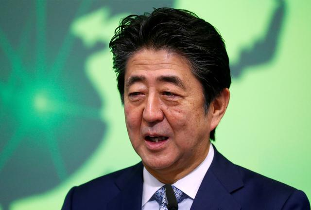 FILE PHOTO: Japan's Prime Minister Shinzo Abe speaks during the conference Communication Connecting Europe and Asia, in Brussels, Belgium September 27, 2019. REUTERS/Francois Lenoir/File Photo
