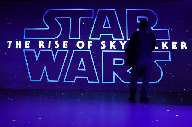 "FILE PHOTO: A man watches a trailer for ""Star Wars: The Rise of Skywalker"" at the Dolby store in the Manhattan borough of New York City, New York, U.S., December 5, 2019. REUTERS/Carlo Allegri/File Photo"