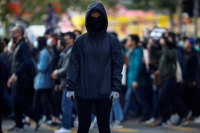Anti-government protester Fiona during a march organised by the Civil Human Rights Front in Hong Kong, December 8, 2019. Picture taken December 8, 2019.   REUTERS/Thomas Peter