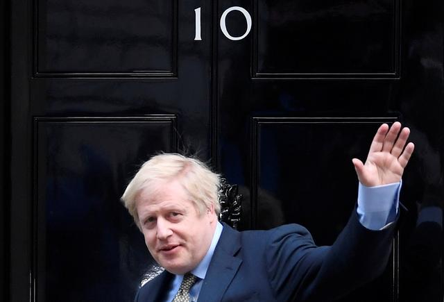 Britain's Prime Minister Boris Johnson waves as he arrives at Downing Street after meeting with the Queen at the Buckingham Palace to ask for permission to form a government, in London, Britain, December 13, 2019. REUTERS/Toby Melville