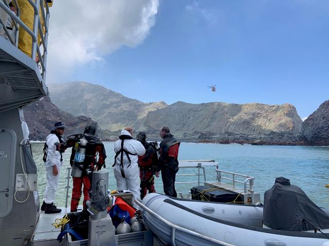 Members of a dive squad conduct a search during a recovery operation around White Island, which is also known by its Maori name of Whakaari, a volcanic island that fatally erupted earlier this week, in New Zealand, December 13, 2019 in this handout photo supplied by the New Zealand Police. New Zealand Police/via REUTERS