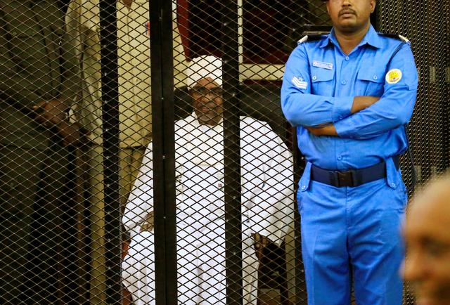 Sudanese former president Omar Hassan al-Bashir sits inside a cage during the hearing of the verdict that convicted him of corruption charges in a court in Khartoum, Sudan. December 14, 2019. REUTERS/Mohamed Nureldin Abdallah