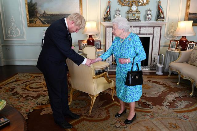 FILE PHOTO: Queen Elizabeth II welcomes Boris Johnson during an audience in Buckingham Palace, where she  officially recognised him as the new Prime Minister, in London, Britain July 24, 2019. Victoria Jones/Pool via REUTERS/File Photo