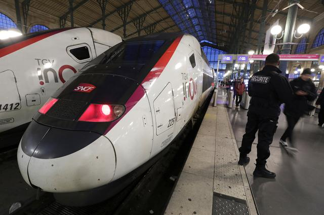 SNCF security guard stands by a TGV train at Gare du Nord train station during a strike by all unions of French SNCF workers and the Paris transport network (RATP), as France faces its tenth consecutive day of strikes against French government's pensions reform plans, in Paris, France, December 14, 2019. REUTERS/Eric Gaillard