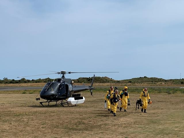 New Zealand Police Search and Rescue and Disaster Victim Identification staff return to Whakatane Airport after conducting a search for bodies in the aftermath of the eruption of White Island volcano, which is also known by its Maori name Whakaari, December 15, 2019. New Zealand Police/Handout via REUTERS