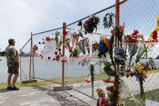 FILE PHOTO: A man looks at a memorial at the harbour in Whakatane, following the White Island volcano eruption in New Zealand, December 11, 2019. REUTERS/Jorge Silva