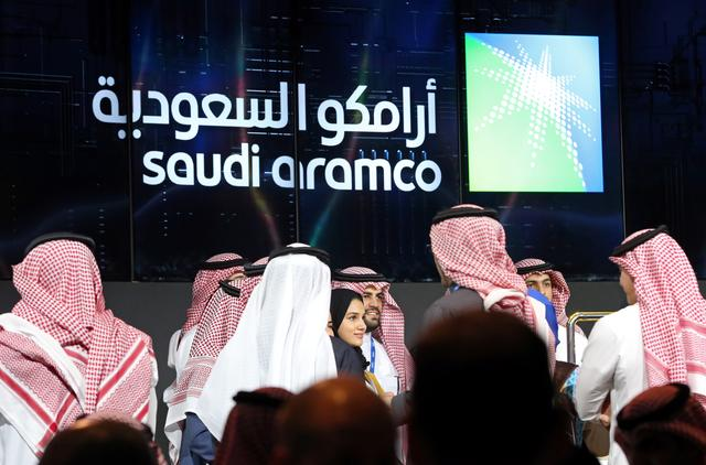 FILE PHOTO: Participants attend the official ceremony marking the debut of Saudi Aramco's initial public offering (IPO) on the Riyadh's stock market, in Riyadh, Saudi Arabia, December 11, 2019. REUTERS/Ahmed Yosri