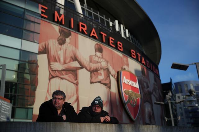 Soccer Football - Premier League - Arsenal v Manchester City - Emirates Stadium, London, Britain - December 15, 2019  Fans outside the stadium before the match  REUTERS/Hannah McKay