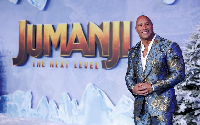 "FILE PHOTO: Cast member Dwayne Johnson poses at the premiere for the film ""Jumanji: The Next Level"" in Los Angeles, California, U.S., December 9, 2019. REUTERS/Mario Anzuoni/File Photo"