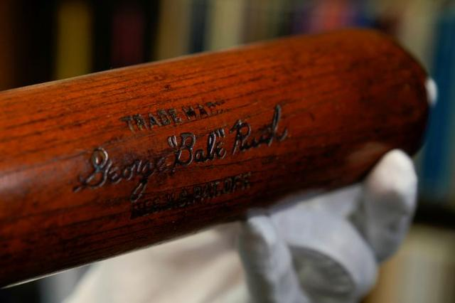 FILE PHOTO: Babe Ruth's 500th home run bat is held by SCP Auctions president David Kohler before it goes up for auction in Laguna Niguel, California, U.S., November 25, 2019. REUTERS/Mike Blake/File Photo