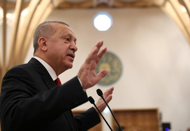 FILE PHOTO: President of Turkey Recep Tayyip Erdogan adresses the audience during the official opening of the new Cambridge Central Mosque, in Cambridge, Britain, December 5, 2019. Murat Cetinmuhurdar/Presidential Press Office/Handout via REUTERS/File Photo