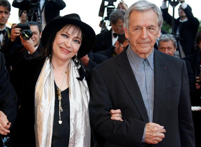 FILE PHOTO: French film actress Anna Karina and director Costa Gavras arrive for a screening at the Cannes Film Festival, Cannes, France, May 16, 2009. REUTERS/Eric Gaillard/File Photo