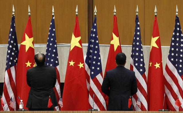 FILE PHOTO: Chinese and U.S. flags are arranged during the third annual U.S.-China Strategic and Economic Dialogue (S&ED) at the State Department in Washington May 9, 2011. REUTERS/Kevin Lamarque
