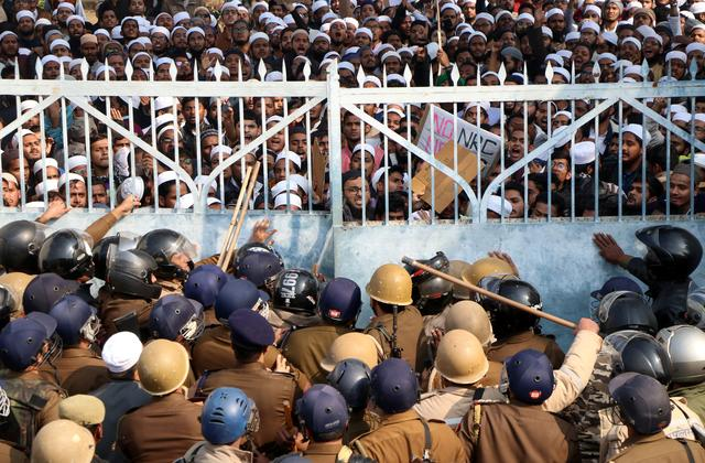 Students of Darul Uloom Nadwatul Ulama, an Islamic university, are stopped by police during a protest against a new citizenship law, in Lucknow, India, December 16, 2019. REUTERS/Stringer