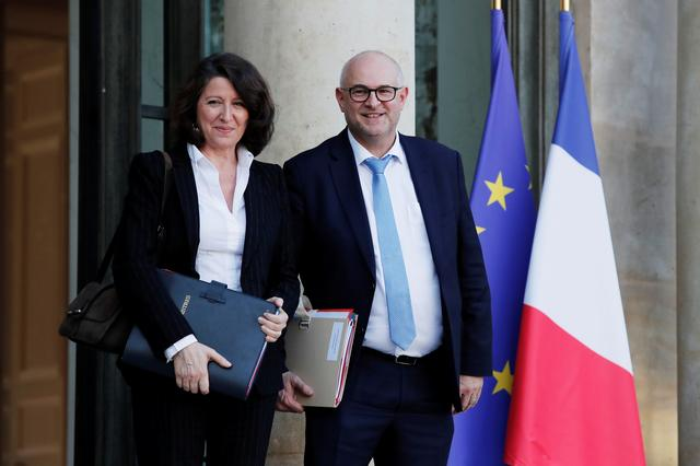 French Health and Solidarity Minister Agnes Buzyn and French High Commissioner for Pension Reform Laurent Pietraszewski leave the Elysee Palace following the weekly cabinet meeting in Paris, France, December 18, 2019. REUTERS/Benoit Tessier