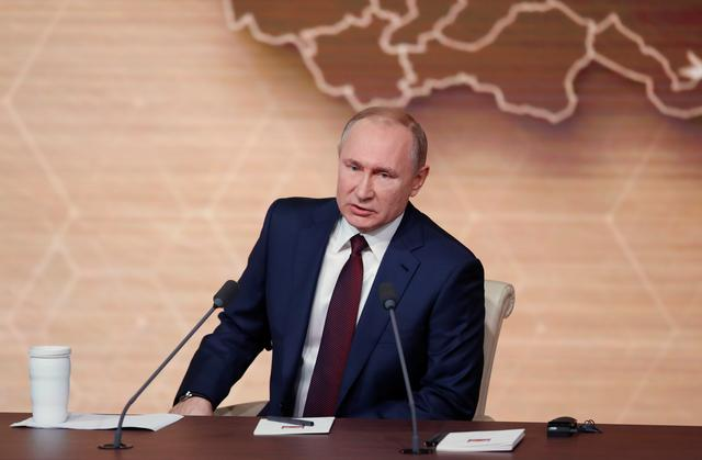 FILE PHOTO: Russian President Vladimir Putin attends his annual end-of-year news conference in Moscow, Russia December 19, 2019. REUTERS/Evgenia Novozhenina