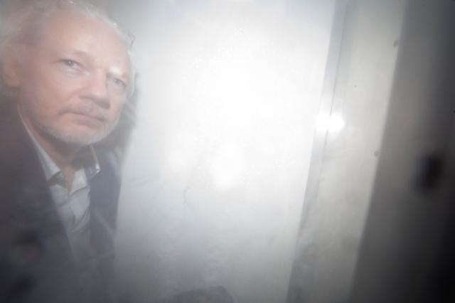 Wikileaks founder Julian Assange arrives at Westminster Magistrates Court in London, Britain, December 20, 2019.  REUTERS/Henry Nicholls