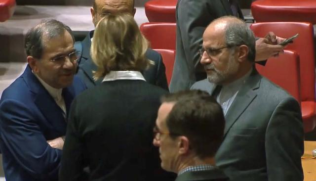 U.S. Ambassador to the United Nations Kelly Craft speaks with Iran's U.N. Ambassador Majid Takht Ravanchi in the U.N. Security Council chamber in New York City, U.S. in a still image from video taken December 19, 2019.  UN TV via REUTERS.
