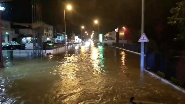 A flooded street is pictured as Storm Elsa sweeps through Trofa, in Porto, Portugal, December 20, 2019, in this still image taken from a social media video./via REUTERS