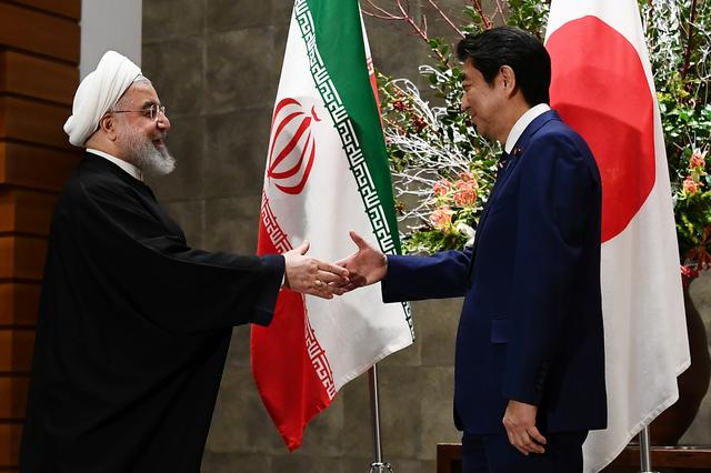 Japanese Prime Minister Shinzo Abe and Iranian President Hassan Rouhani meet in Tokyo, Japan, December 20, 2019. Charly Triballeau/Pool via REUTERS