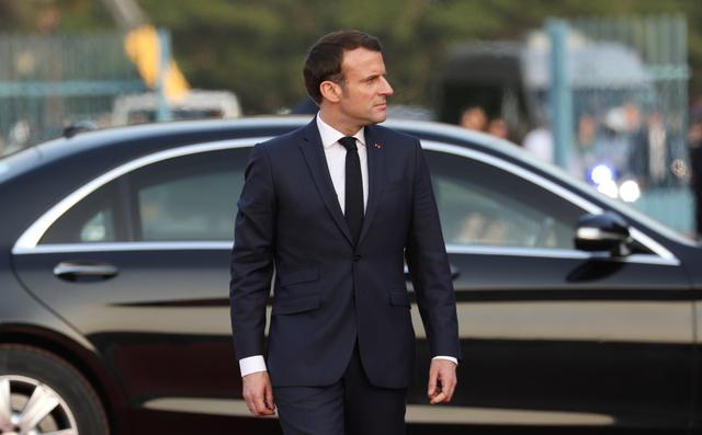 France's President Emmanuel Macron arrives for a meeting with Ivory Coast President Alassane Ouattara at the Petit Palais in Abidjan, Ivory Coast, December 21, 2019. REUTERS/Luc Gnago