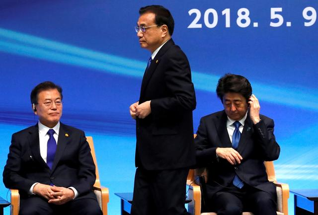 FILE PHOTO: Japan's Prime Minister Shinzo Abe, South Korea's President Moon Jae-in and China's Premier Li Keqiang attend the 6th JAPAN-CHINA-KOREA Business Summit in Tokyo, Japan May 9, 2018.  REUTERS/Toru Hanai/File Photo